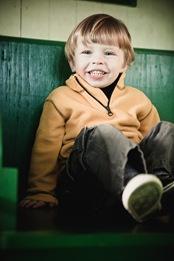 boy sitting in train car at Baltimore & Ohio Railroad Museum
