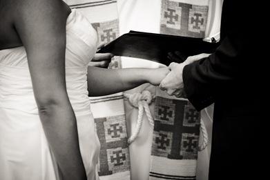 groom placing ring on brides finger at Mt. Airy Mansion in Upper Marlboro Maryland