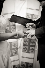 bride placing ring on grooms finger at Mt. Airy Mansion in Upper Marlboro Maryland