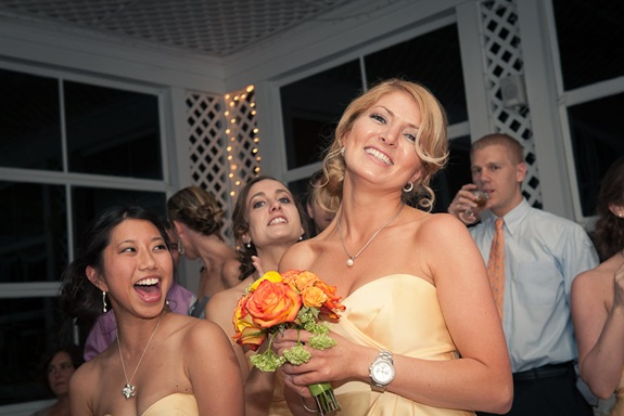 bridesmaid with caught wedding bouquet at Mt. Airy Mansion in Upper Marlboro Maryland