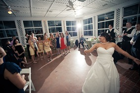bride tossing flowers at Mt. Airy Mansion in Upper Marlboro Maryland
