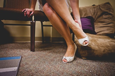 bride putting shoes on in bay area community church in annapolis md