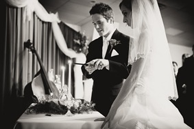 Bride and groom lighting unity candle in Mechanicsville MD
