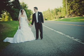 Bride and groom standing by road in mechanicsville md