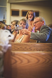 family members taking video of wedding at Annapolis EP Church