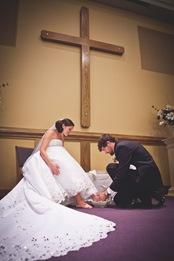 groom washing bride's feet during wedding at Annapolis EP