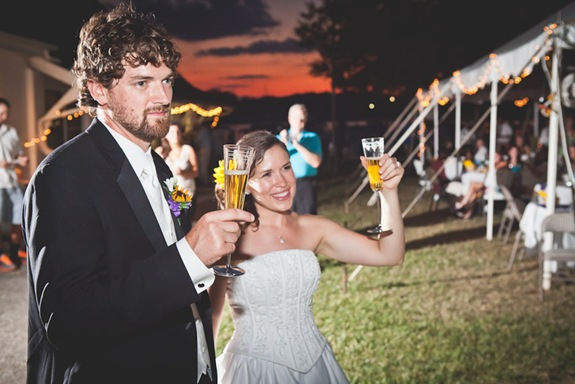 Bride and Groom toasting during wedding reception at Bay Ridge Club in Annapolis MD