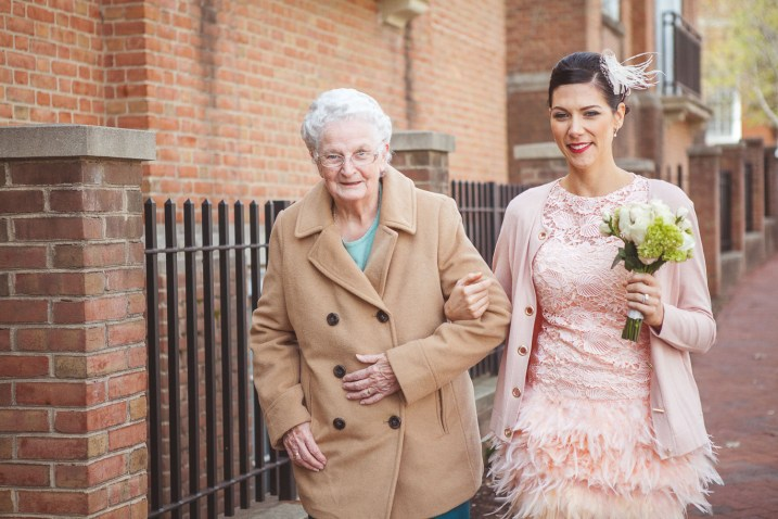 bride walking with grandmother after wedding ceremony