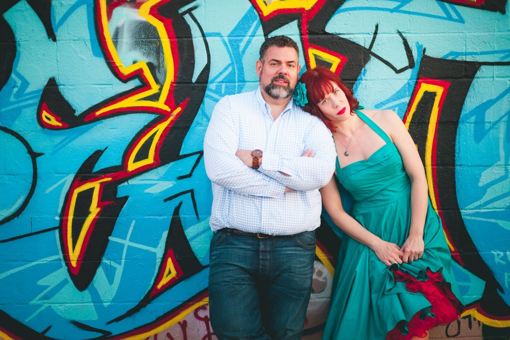 The shape of this dress matches the swooping shapes in the scene's graffiti, and the color matches the dominant color in the scene.