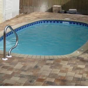 Fiesta 10' x 20' Pettit Fiberglass Pool with pavers and tile