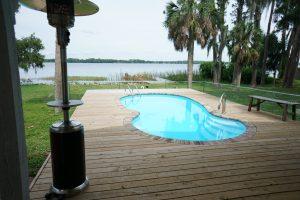 Laguna 11' x 23' Pettit Fiberglass Pool with deck