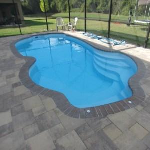 Millennium 12' x 25' Pettit Fiberglass Pool with bull nose pavers and paver deck