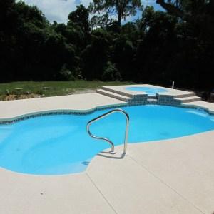 Millennium 12' x 25' Pettit Fiberglass Pool with tile and overflow spa
