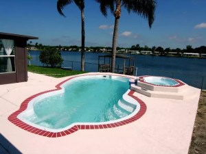 Millennium Pettit Fiberglass Pool with Overflow Spa and Deck