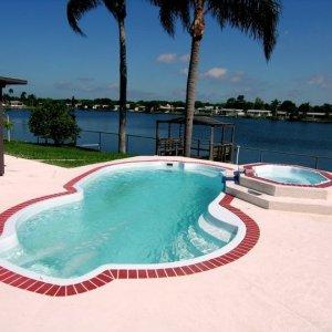 Millennium Pettit Fiberglass Pool with Overflow Spa and Deck