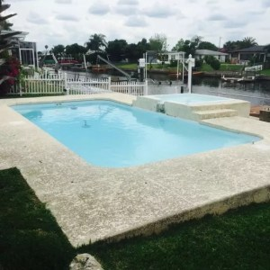 Tropical 13' x 25' Pettit Fiberglass Pool with deck and overflow spa