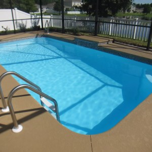 Tropical 13' x 25' Pettit Fiberglass Pool with waterfall cantilever and waterline tile