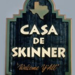 This is a hand painted and gold leafed sandblasted redwood sign for Casa de Skinner