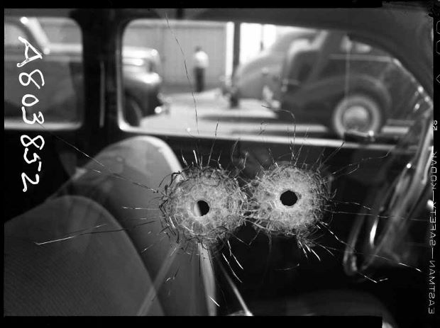 Detail of two bullet holes in car window, 1942 ©LAPD /Image courtesy of fototeka