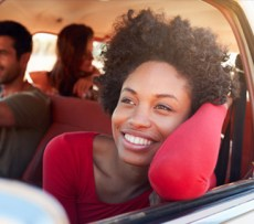 Woman looking out of car window smiling
