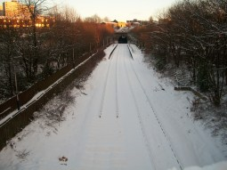 Oldham Werneth Rail station covered in snow, after closure of line for conversion to Metrolink