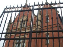 Exterior, Nicholls House, Ardwick, Manchester. Imposing gates in front of building