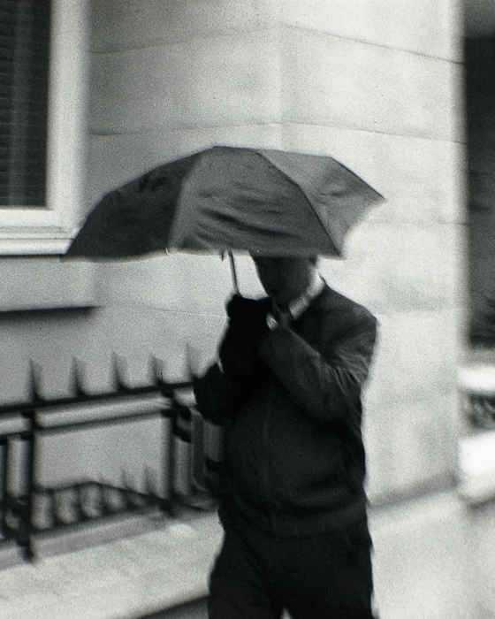 Man with Umbrella blurred street photography image