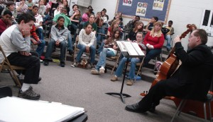 Phillip Serna presenting a Viols in Our Schools presentation to students in Aurora, IL