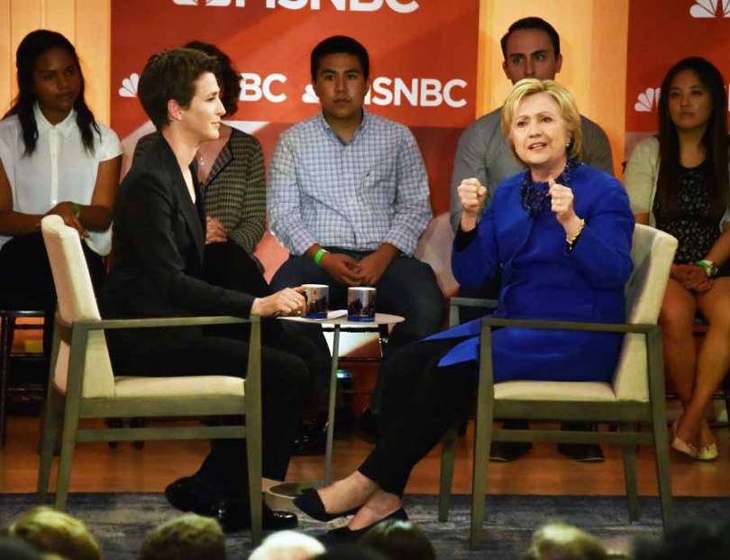 Hillary was jovial in her Q&A with Rachel, but got serious when a protestor stood up and asked Hillary Clinton about women and families who are being held in immigration detention facilities. Instead of ignorning her, Rachel Maddow turned and asked Hillary Clinton the question the women wanted to know. Clinton said she was against that and when she was elected she would end family detention and pass immigration reform. The women sat down, but the security guards did take away her protest sign.