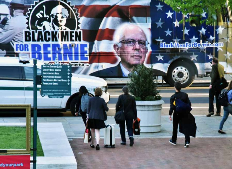 While Clinton was still on stage, Bernie Sanders arrived at the side door of the Constitution Center on 6th Street. He was not happy when he heard Clinton was still on stage as he expected to just enter the building, and not see her before taking the stage to be interviewed by MSNBC's Chris Hayes. At one point he told his police escort, and entourage that he was going to skip the MSNBC Town Hall and they should prepare to leave. MSNBC assured him that they would not see each other. People on the scene said Bernie emerged from his suv red faced, and did not turn and wave to his supporters. Hillary on the other hand emerged from the building with a broad smile waving to the crowd as she got into her SUV. BTW that is Rachel Maddow 3rd from the right, carrying her bags to her waiting SUV.