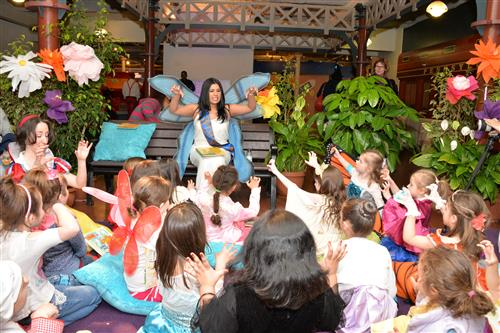 "Sudipta Bardhan-Quallen, Children's Book Author reads her book ""Tyrannosaurus Wrecks"" at the Storybook Ball."