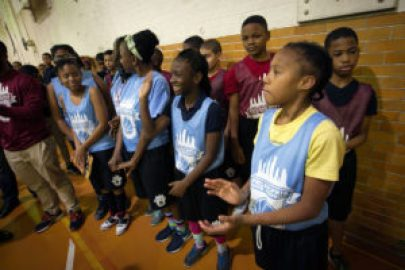 Picture of a group of Philadelphia Youth Basketball players at Jay Cooke Middle School. A press conference was held at Jay Cooke Middle School, 13th and Louden in Logan section of the city on Thursday afternoon December 3, 2015. The presser was in reference to Philadelphia Youth Basketball development in the Logan section. ( ALEJANDRO A. ALVAREZ / Staff Photographer )