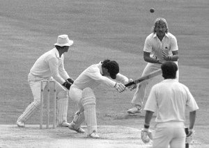 England's Ian Botham catches Aussie skipper Allan Border