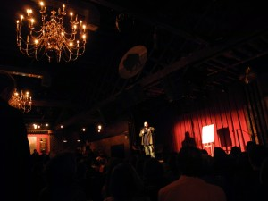 Peter Aguero on stage compering The Moth at The Bell House in Brooklyn