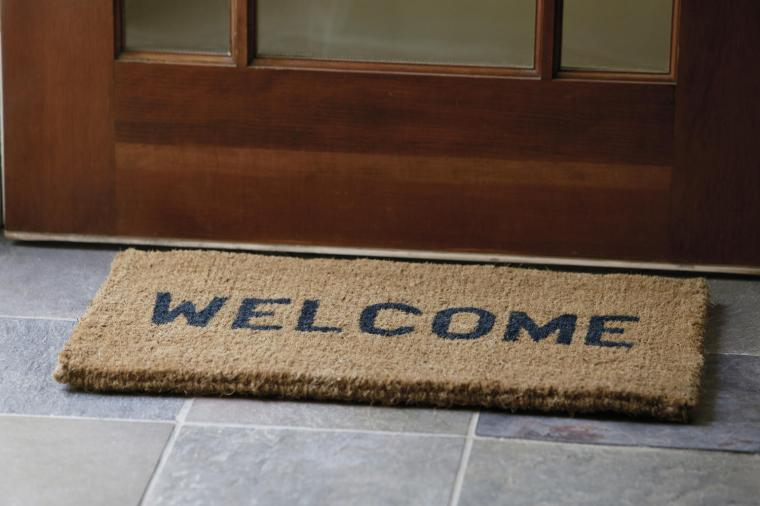 Photo of a welcome mat.