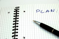 "Pad of paper with writing on it that says ""Plan."""