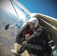 Skydiver, preparing to jump.