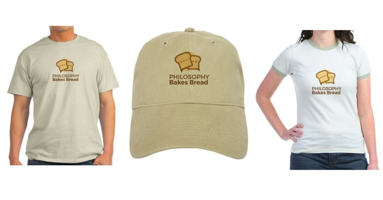 Photo of a men's tshirt, a cap, and a woman's tshirt, each featuring the logo for Philosophy Bakes Bread.