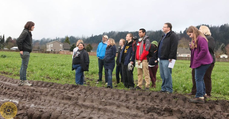 Image of Food Symposium participants visiting Mother Earth Farms in Washington state.