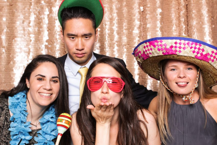 The bride blowing a kiss next to three friends in the Rancho Palos Verde Photo Booth