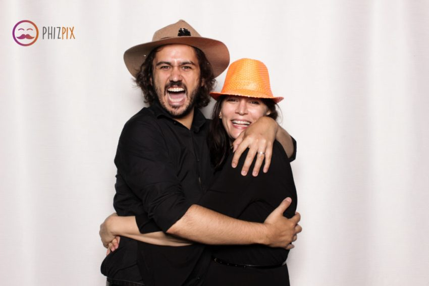 A girl and guy hugging in the Malibu photo booth