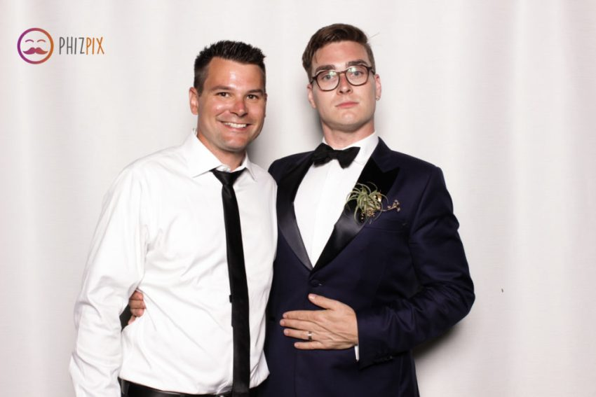 The groom and a friend looking smart in the Malibu photo booth
