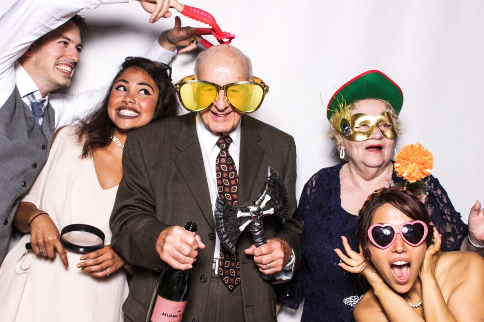 Grandparents having fun with the bride and groom in their Phizpix party photo booth