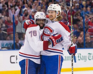 TAMPA, FL - May 7: P.K. Subban #76 and Jeff Petry #26 of the Montreal Canadiens celebrate a goal against the Tampa Bay Lightning during the second period in Game Four of the Eastern Conference Semifinals during the 2015 NHL Stanley Cup Playoffs at the Amalie Arena on May 7, 2015 in Tampa, Florida.  (Photo by Scott Audette/NHLI via Getty Images)