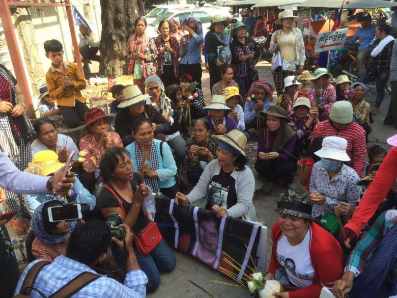 A group of protestors with incense sticks outside Phnom Penh Appeal Court this morning.