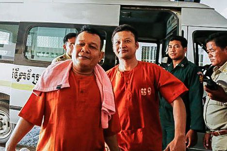 Chay Sarith (left) and Mao Heun at the Phnom Penh Municipal Court in April after being charged with beating CNRP lawmakers.