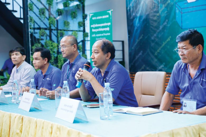 """Speakers discuss the recent commune elections at a press conference held from the """"Situation Room"""" last month in Phnom Penh."""