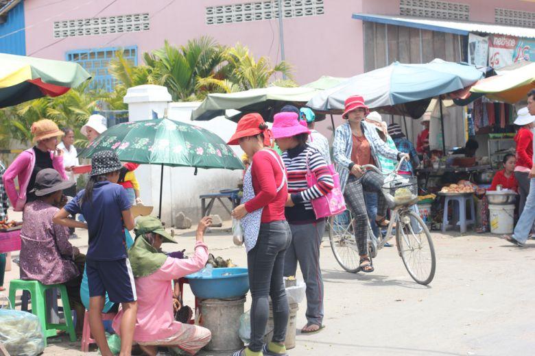 Garment workers take a break in Kandal's Svay Rolum commune last week.