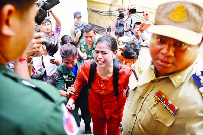 Boeung Kak activist Tep Vanny being escorted by officials to the Supreme Court yesterday in Phnom Penh.