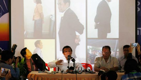 Kem Sokha (centre) talks to the media at the CNRP headquarters in Phnom Penh